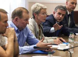 Former Ukrainian President Kuchma, OSCE Ambassador Tagliavini and Russian Ambassador to Ukraine Zurabov attend a meeting with leaders of the self-proclaimed Donetsk People's Republic and Luhansk People's Republic in the city of Donetsk
